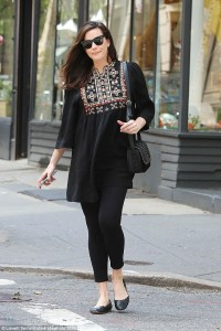 Liv Tyler has that post-baby glow in black embroidered blouse and leggings during NYC stroll less than three weeks after giving birth to daughter