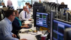 FTSE 100 slips after hitting record high, as pound extends falls