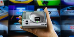 THIS AWESOMELY TINY GAMING CONSOLE PLAYS RETRO GAMES FROM 28 DIFFERENT SYSTEMS