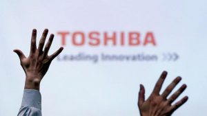 Toshiba Signs Deal to Sell Chip Unit to Bain-Led Group for $18 Billion
